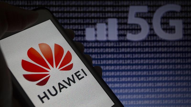 An image of a Huawei logo displayed on a smartphone screen, with a 5G connection symbol in the background