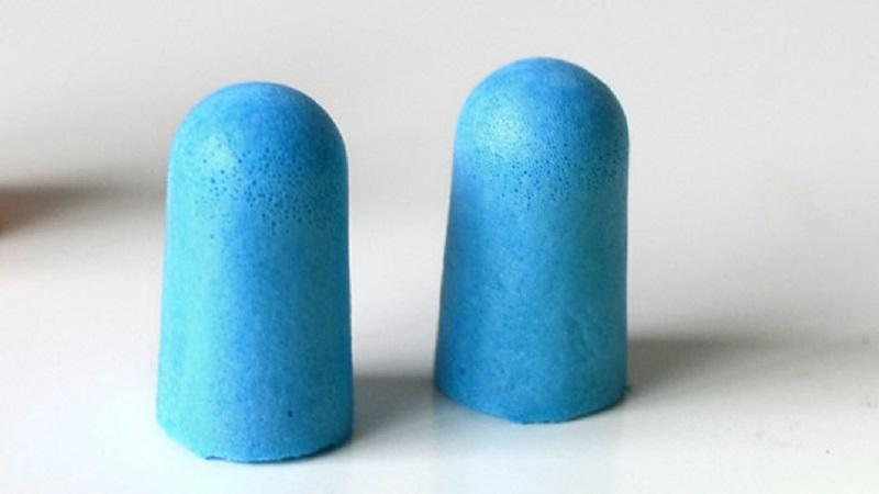 An image of a pair of foam earplugs