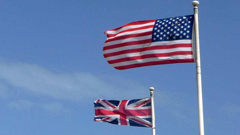 An image of the US and UK flags flying next to one another