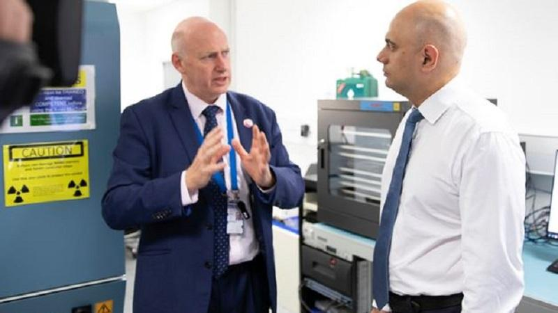 Home secretary Sajid Javid (on the right) pictured examining the new anti-child abuse technology with Mark Stokes, head of the cyber forensics unit of London's Metropolitan Police