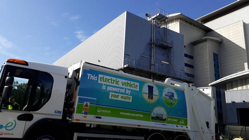 An image of a waste-powered bin lorry being charged at Sheffield's Energy Recovery Facility