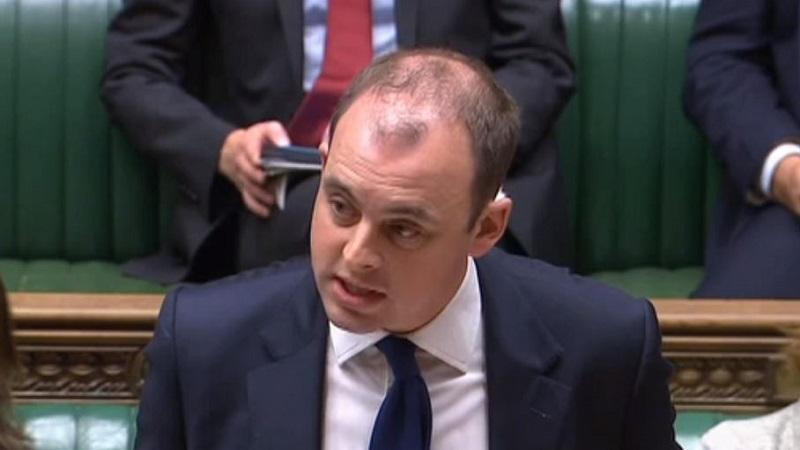 An image of digital minister Matt Warman addressing the House of Commons