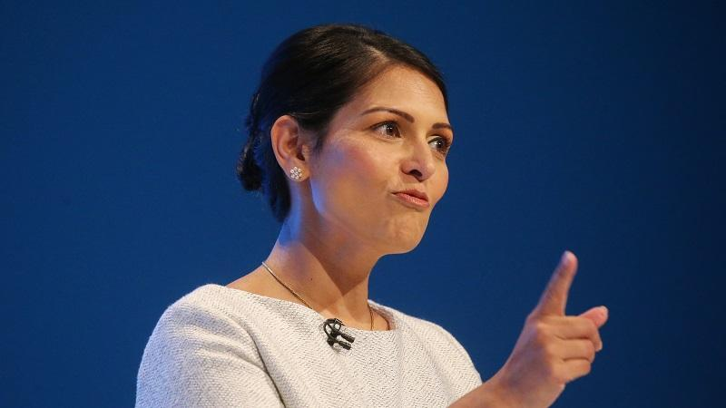 A head-and-shoulders image of home secretary Priti Patel speaking at the Conservative party conference 2019