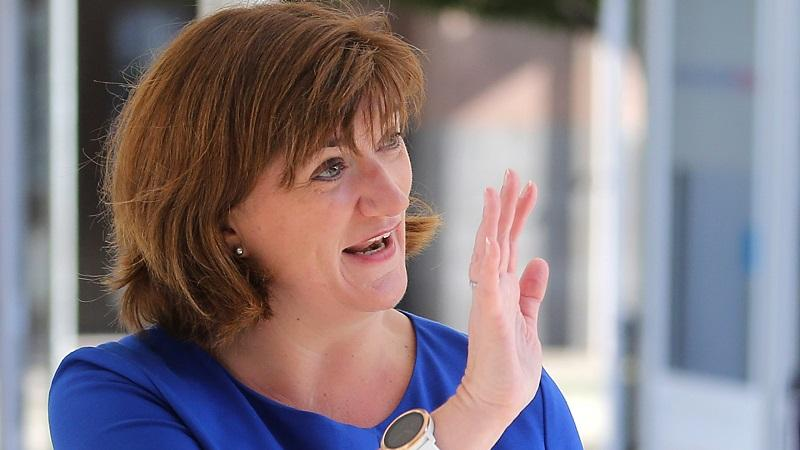 An image of Conservative politician Nicky Morgan waving at someone out of shot