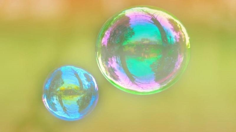 An image of two bubbles - the one on the right is about twice the size of the one on the left