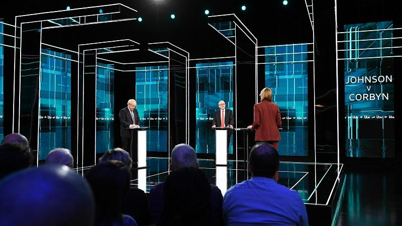 A long-range image of Boris Johnson and Jeremy Corbyn taking part in a studio debate hosted by ITV's Julie Etchingham