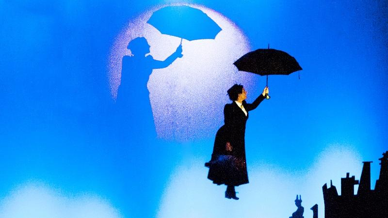 An image of a Mary Poppins character floating in the sky with her umbrella
