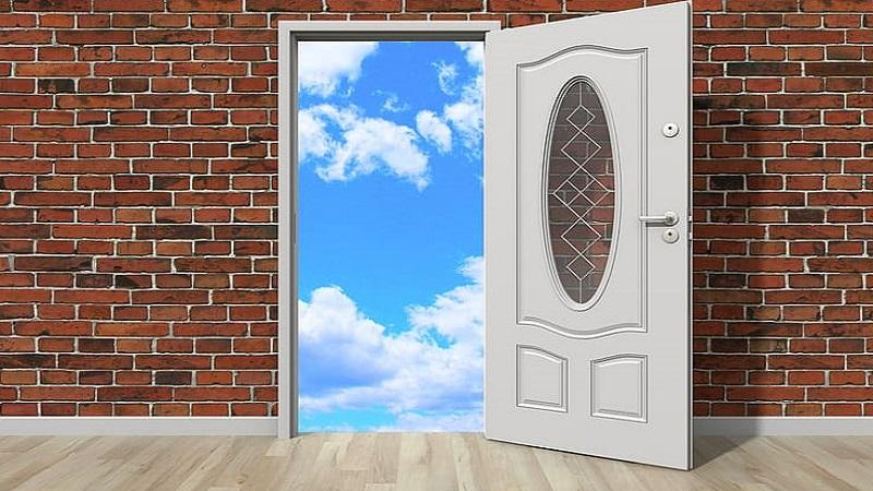 An illustration of a door opening onto a blue sky with clouds