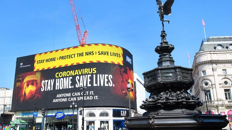An image of a government coronavirus communication in London's Trafalgar Square