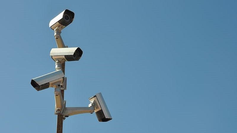 An image of multiple surveillance cameras attached to a mast