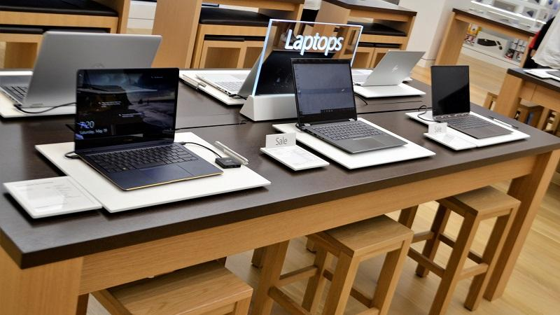 An image of laptops in a store showroom