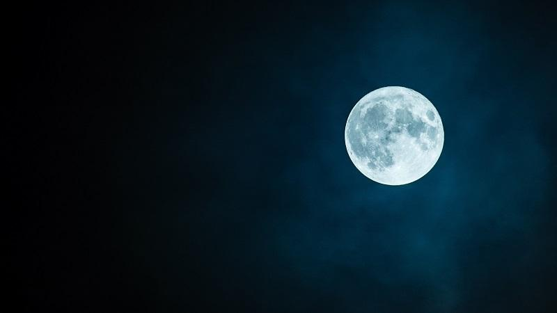 An image of the moon in a clear night sky