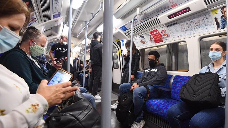 An image of passengers wearing face masks on a London Underground Jubilee Line train