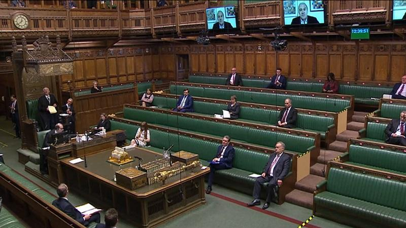 An image of a socially distanced House of Commons with MPs appearing on overhanging video screens