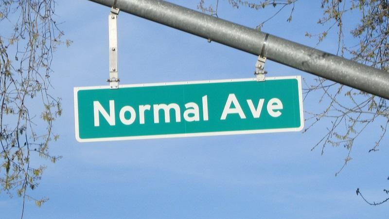 An image of a street sign reading 'Normal Ave'