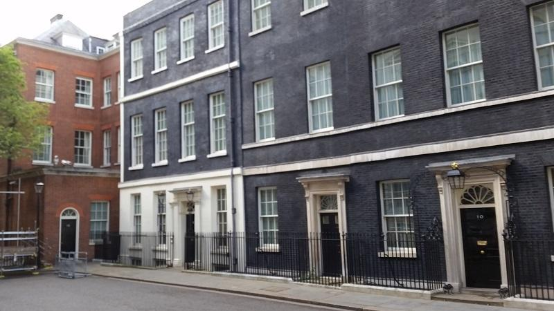 An image of Downing Street with number 10 in the foreground on the right