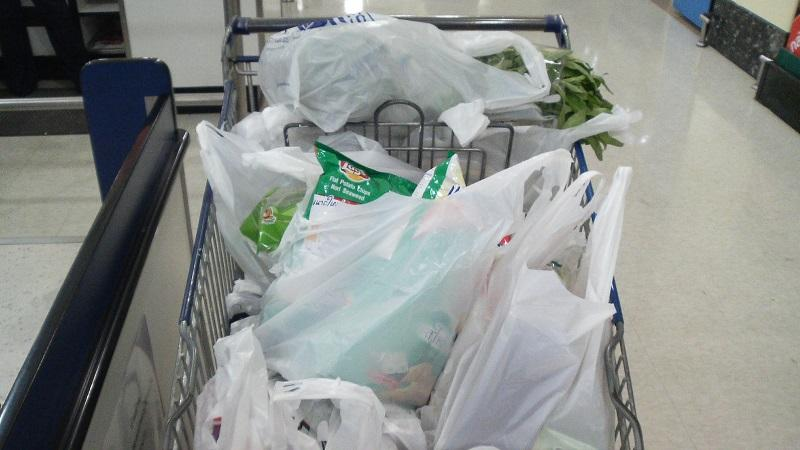 An image of a supermarket shopping basket full of shopping bags