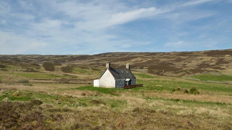 An image of a remote house in the Scottish highlands