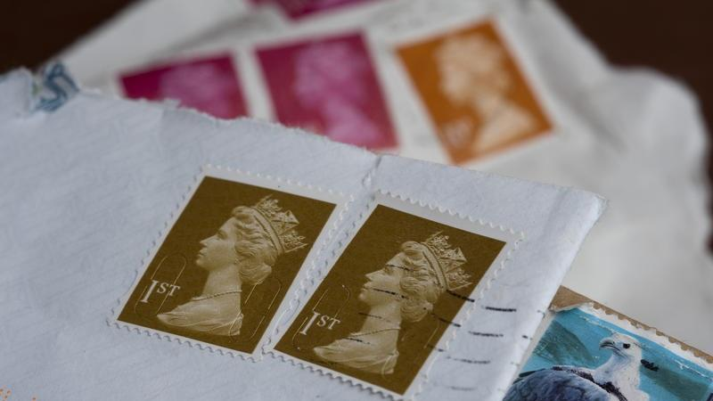 A close-up of several images of stamped letters in a small pile