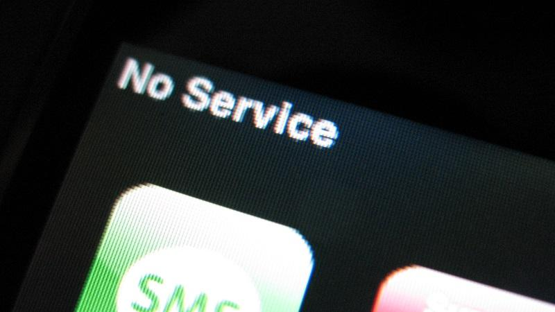 A close-up of the top right-hand corner of a phone screen displaying a 'no service' message