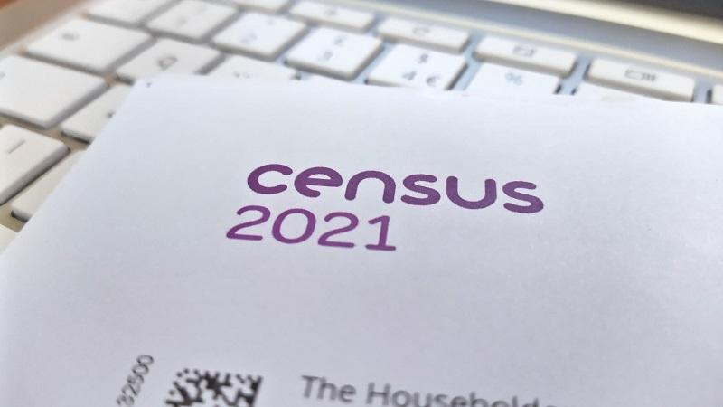 An image of a Census 2021 letter lying on top of a keyboard