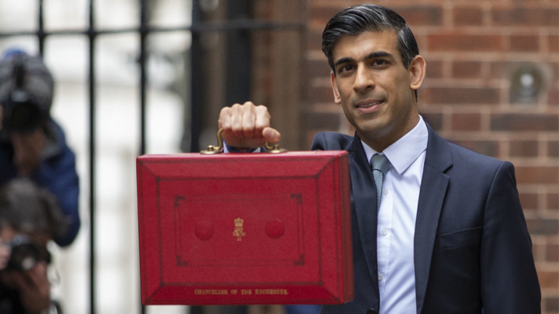 Chancellor Rishi Sunak holds aloft the red budget briefcase