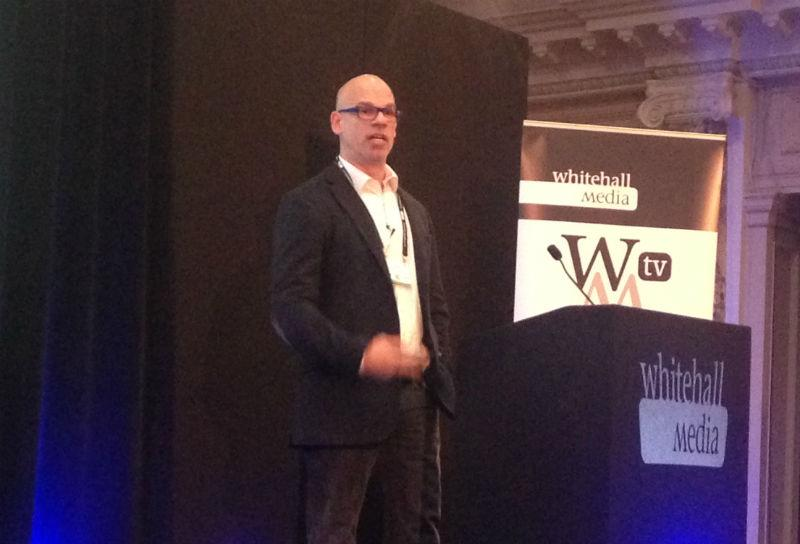 image of Paul Shetler, chief digital officer at the Ministry of Justice, giving a speech