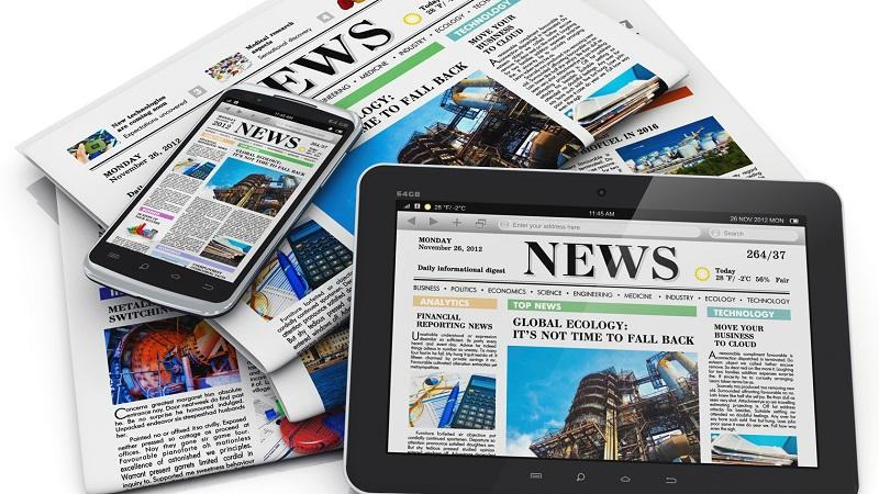 An image of a selection of news stories displayed on newspapers and different device screens