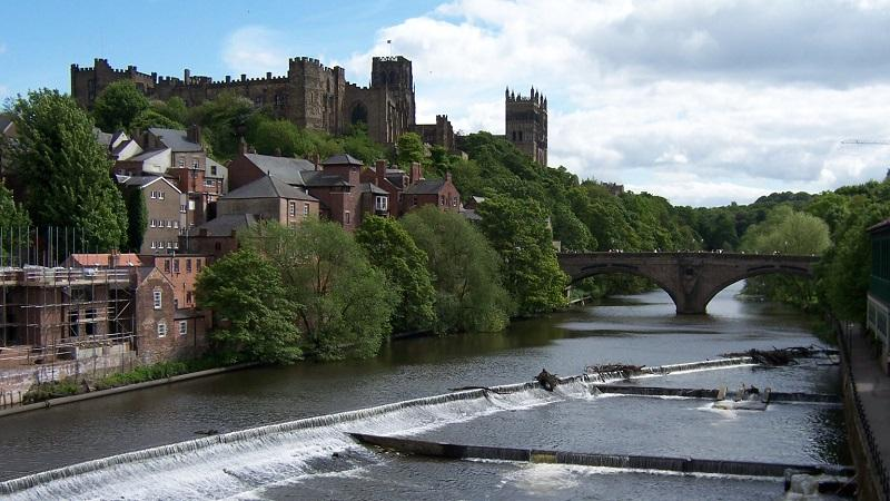 An image of Durham Castle and Cathedral  and Milburngate bridge with the River Wear in the foreground