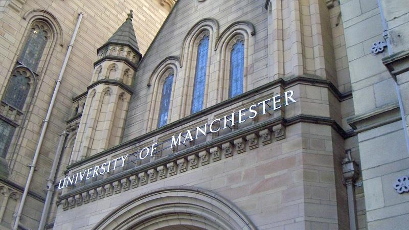 A close-up image of a 'University of Manchester' sign on the Whitworth building
