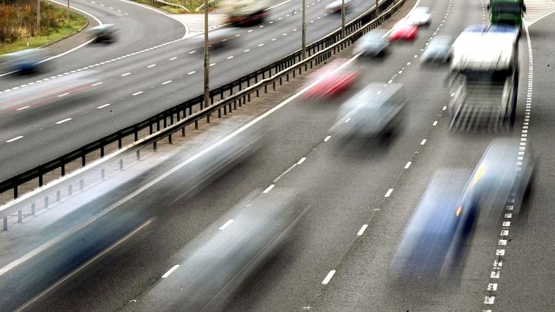 An image of traffic moving fast on a motorway